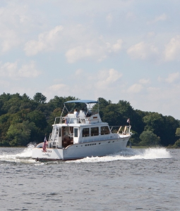 While Karen admired the fall foliage I enjoyed the sight of a classic Huckins cruising passed us.